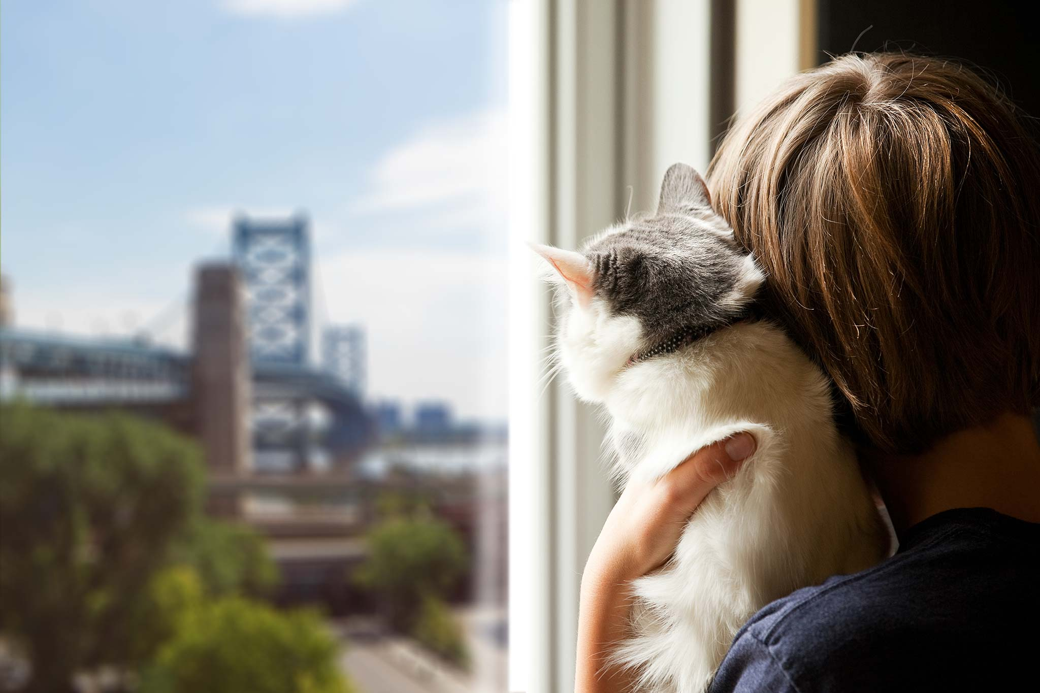 Woman With Cat Looking at Bridge